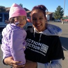 Alejandra Gomez poses with her 2-year-old daughter on Election Day in November. Gomez, an undocumented immigrant who worked for an activist group during the election, says having a New Mexico driver's license reduces the chance of deportation. (Image courtesy of Comunidades en Acción y de Fé)