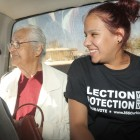 Alejandra Gomez, right, is an undocumented immigrant who has a New Mexico driver's license. On Election Day in November she helped transport 86-year-old Maria Prieto of Chaparral, left, to a polling place in Southern New Mexico so she could vote. The two are shown here in the backseat of a pickup truck before heading to the polling place. (Steve MacIntyre/New Mexico In Depth)