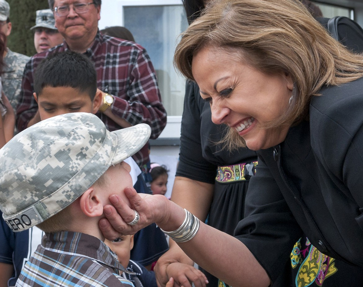 Gov. Susana Martinez shares a moment with Tyler Lucero, 7, of Alamogordo, who is wearing his father's hat after a Yellow Ribbon Ceremony in Las Cruces in January. Martinez says her vision centers on improving education so New Mexico's children are equipped to land good jobs and attracting those jobs to New Mexico so the state's children can stay here if they choose. (Gary Mook/for the Las Cruces Sun-News)