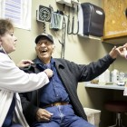 Remigio Archuleta jokes with Dr. Suzanne Norman, left, and Medical Assistant Elizabeth Medina during a Jan. 3 check up at Las Clinicas Del Norte in Abiquiú. Many of Norman's patients lack health coverage and could qualify for the government's health insurance program for the poor if Gov. Susana Martinez decides to expand Medicaid in New Mexico. (Craig Fritz/New Mexico In Depth)