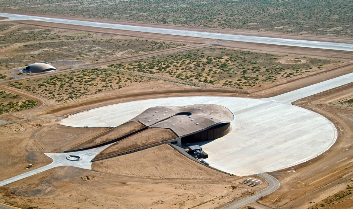 Aerial view of the Virgin Galactic Gateway to Space building (center), Spaceport Operations Center dome building (far left), spaceport runway, taxiway and apron at Spaceport America. (Image courtesy of Spaceport America)