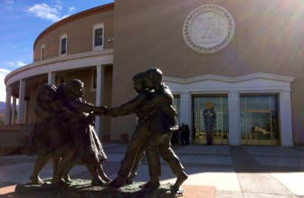 A statue of children outside the Roundhouse in Santa Fe.