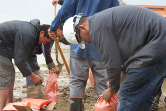 Navajo Technical University students and staff in Crownpoint clean up flood damage in September.