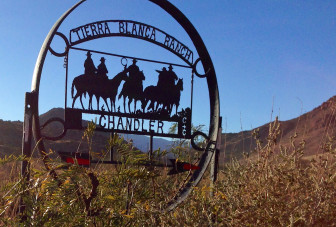 A sign pointing the way to nearby Tierra Blanca Ranch, which occupies a 30,000-acre area surrounded by the Gila National Forest in rural Sierra County south of Hillsboro.