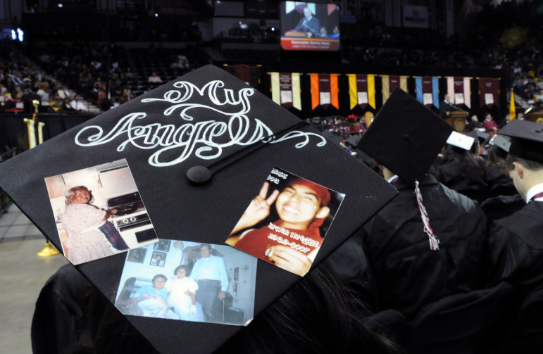 "Decorating the back of Aileen Cruz's black cap on graduation day were photos of her cousin Irwin Wright and other deceased relatives. ""He was one of the main reasons why I wanted to go and get a degree,"" Cruz said of her cousin."