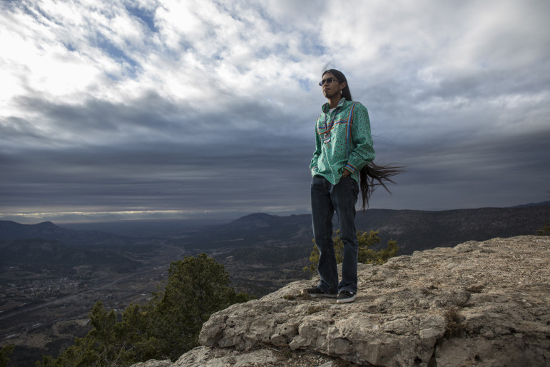 Coloradas Mangas, who works in suicide prevention, stands silent atop a peak in the Sacramento Mountains overlooking the Mescalero Apache Reservation with tears streaming from his eyes. Dec. 4, 2014, the day this photo was taken, was the first time he saw this view of his community.