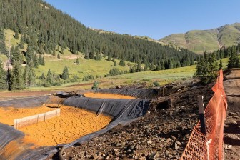 Settling ponds used to precipitate iron oxide and other suspended materials from nearby Red and Bonita mines drainage are shown in this Aug. 14 photo. (Credit: Eric Vance/EPA)