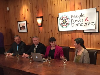 Sens. Bill Soules and Sander Rue discuss capital outlay reform with Gwyneth Doland and Viki Harrison of Common Cause.