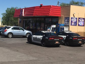 Two Albuquerque police cruisers sit in the Circle K parking lot at Central and Pennsylvania NE where, 10 days prior, undercover officers arrested several homeless people in a reverse drug sting.