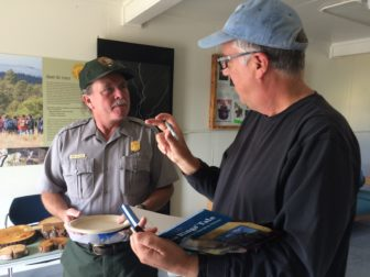 """Talking with a fan, John Fleck signs a copy of his 2009 book, """"The Tree Rings' Tale: Understanding Our Changing Climate."""""""