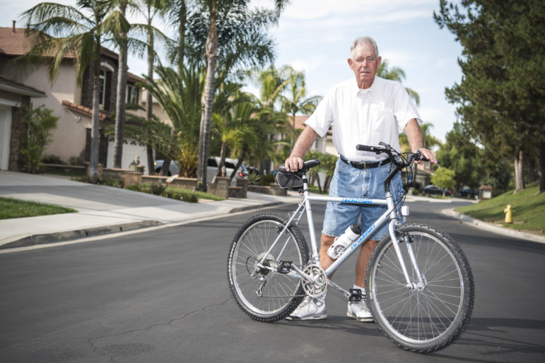 Tom Chudzinski with his bike on the residential street in Mission Viejo, CA where he is currently staying.