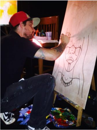 """Skelley Greer creates artwork to be auctioned at """"Hip-Hop for Water"""" event in Albuquerque. Credit: Robert Salas/NMID"""