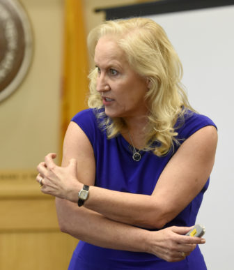 Special prosecutor Randi McGinn demonstrates the wounds suffered by James Boyd the night of his shooting, photographed on Monday September 19, 2016. (Dean Hanson/Albuquerque Journal)